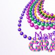 Mardi Gras beads background — Stock Vector #38183247