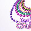 Mardi Gras beads background — Stock Vector #38183247
