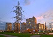 Power line feeding the evening city. — Stock Photo