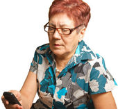 An elderly woman is calling on a cell phone, isolated. — Stock Photo