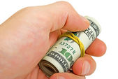 Roll of dollars in a man's hand, isolated. — Stock Photo