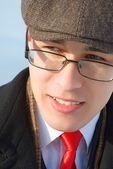 A young man in glasses and classic clothes. — Stock Photo