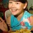 Happy girl at the meal. — Stock Photo