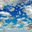 Stock Photo: Dollars in blue sky.