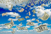Dollars in the blue sky. — Stock Photo
