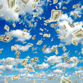 Money falling from the sky. — Stock Photo