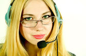 Beautiful young woman in a headset. — Stock Photo
