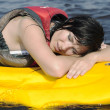 Tired girl lies on surfing — Stock Photo #12070531