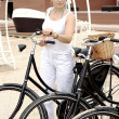 An elegant lady travels on bicycle — Stock Photo #12172210