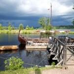 Retro wooden boats near a pier — Stock Photo