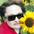Portrait of lady with a sunflower — Stock Photo