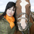 Portrait of beautiful brunette with horse — Stock Photo