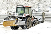 Snow cleaning tractor clears paths — Stock Photo