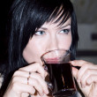 Royalty-Free Stock Photo: Beautiful lady drinks mulled wine