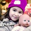 Nice girl with a favourite doll — Stockfoto