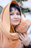 Portrait beautiful woman in a pillow-sham with fur — Stock Photo