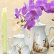 Still life with an orchid and candles — Stock Photo
