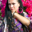 Intent look of beautiful blue - eyed woman with the african pigtails — Stock Photo