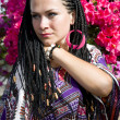 Stock Photo: Blue - eyed womwith africpigtails