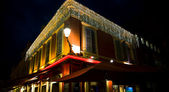 Street bright coloured cafe at night — Стоковое фото