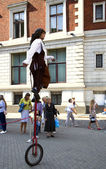 Acrobat doing tricks on unicycle — Stock Photo