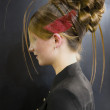 Beautiful hair-do of model on an exhibition — Stock Photo