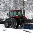 Snow cleaning tractor clears paths — Stock Photo #37644689