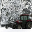 Stock Photo: Snow cleaning tractor clears paths
