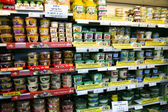 Shelves with foods in supermarket — Stock Photo