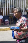Hispanic man sells outside candy — Stock Photo