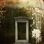 Tombstone on the background of the old masonry — Stock Photo