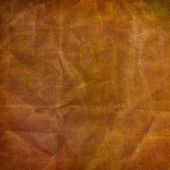 Alienated used paper background with gold ornamental for announ — Stock Photo