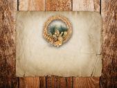 Christmas golden wreath on the old wooden door — Stock Photo