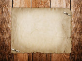 Grunge paper for invitation with thumbtacks on the vintage woode — Stock Photo