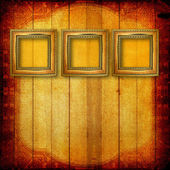 Old wooden Victorian frames on the wall in the room — Stock Photo