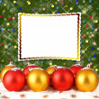 Christmas ball with greeting card on the abstract sparkling back - Stock Photo