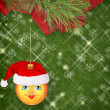 Christmas ball in the hat of Santa Claus with pine branches on t - Stock Photo