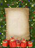 Boże narodzenie kartkę z życzeniami z prezentuje na zielony bac streszczenie — Zdjęcie stockowe