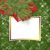 Christmas greeting card with firtree and frame on the green abs — Stock Photo