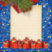 Christmas greeting card with presents on the blue abstract back — Stock Photo