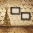 Christmas golden spruce in the old room, decorated with wallpape - Stock Photo