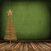 Christmas golden spruce in the old room, decorated with wallpape — Stock Photo