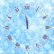 Antique clock face on the abstract background with snowflakes an — Stock Photo