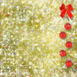 Christmas balls and red bow with bells on abstract snowy backgro — Stock Photo #15965865