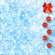 Christmas balls and red bow with bells on abstract snowy backgro — Stock Photo #15967177