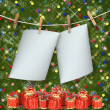 Greeting card hanging on a rope and clothespins with presents o — Stock Photo #16185405