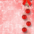 Christmas balls and red bow with bells on abstract snowy backgro — Stock Photo #16187161