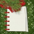 Christmas greeting card with firtree and notebook on the  green — Stock Photo