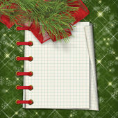 Christmas greeting card with firtree and notebook on the green — 图库照片