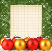 Christmas ball with notebook on the abstract sparkling backgroun — Stock Photo
